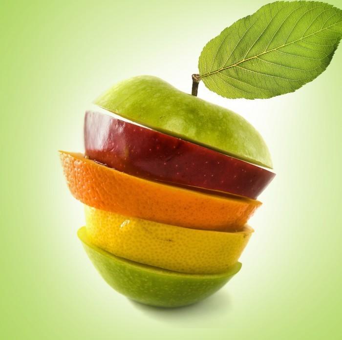 Яркий растровый клипарт с изображением фруктов дольками в виде яблока.