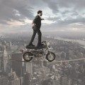 Мужчина на мотоцикле над городом - Man on a motorcycle over the city