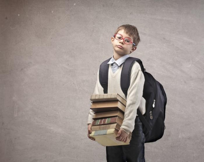 shutterstock 121846870 Мальчик с книгами в руках   Вoy with books in their hands