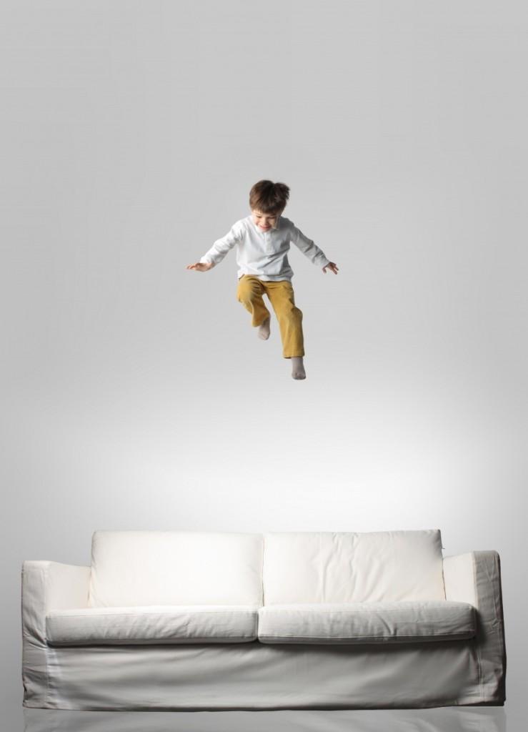 shutterstock 26147653 739x1024 Мальчик прыгает на диване    Boy jumping on the couch