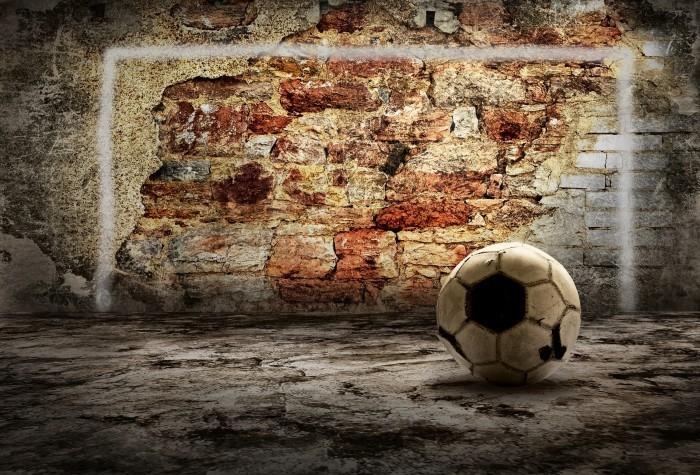 shutterstock 68884288 Футбольный мяч возле кирпичной стены   Soccer ball near a brick wall