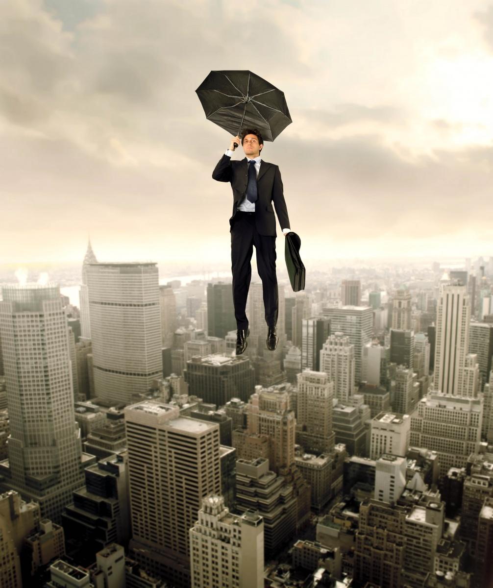 Мужчина с зонтом над городом Мan With An Umbrella Over