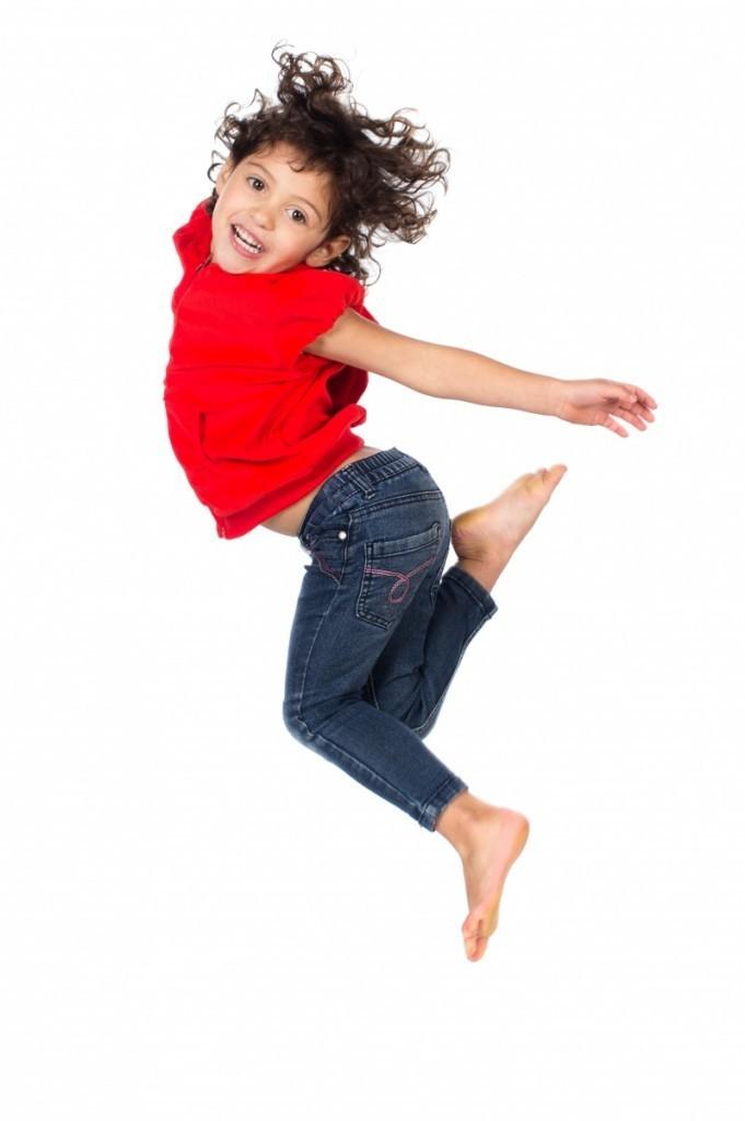 shutterstock 143757841 681x1024 Девочка в прыжке   Girl in a jump
