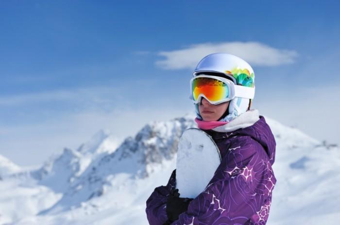 photodune 1607300 700x464 Женщина держит сноуборд   Woman holding a snowboard