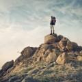 Турист в горах с рюкзаком - Tourist in mountains with a backpack