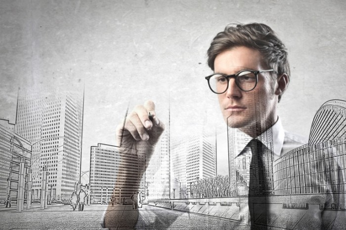 photodune 4156034 700x466 Парень в очках рисует макет   Guy with glasses draws layout