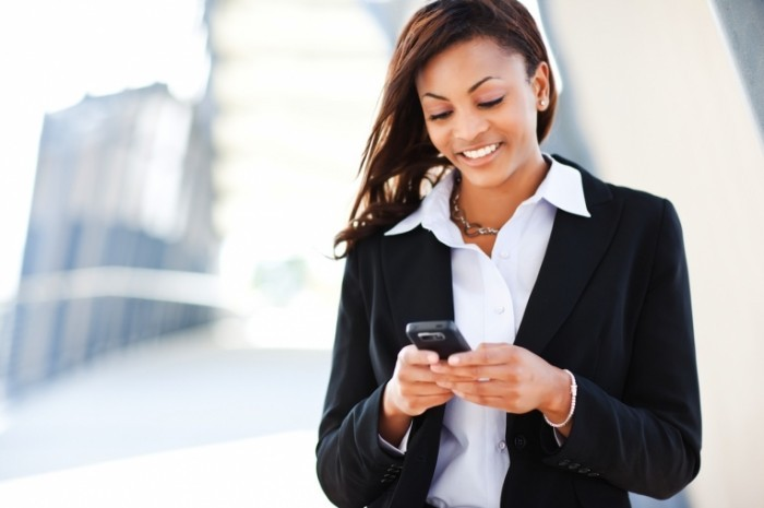shutterstock 60909841 700x465 Бизнес леди с телефоном   Business woman with a phone