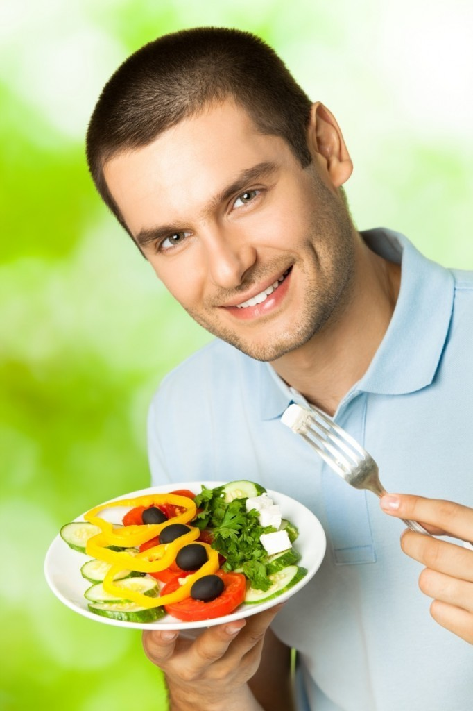 shutterstock 721047581 682x1024 Мужчина с греческим салатом   Man with a Greek salad