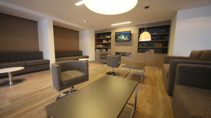 stock footage rest room with sofas tv and bookcases at modern business center 700x393 Интерьер   Interior