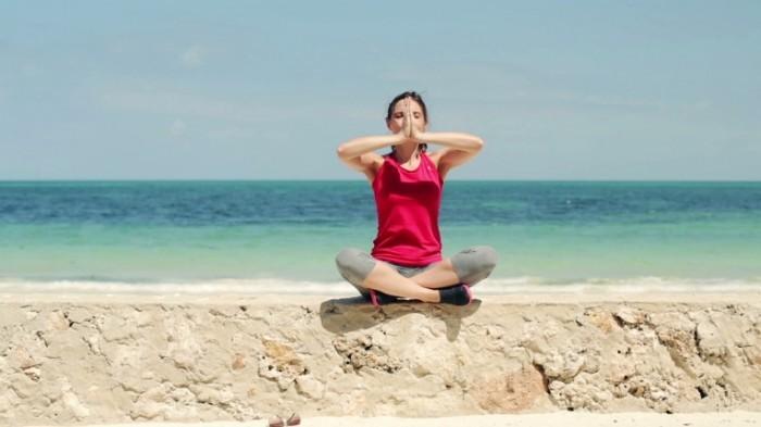stock footage young beautiful woman meditating by the sea 700x393 Медитация   Meditation