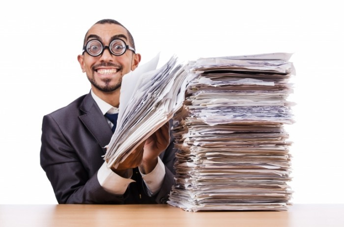 Happy Man with too much Work shutterstock 700x463 Мужчина с пачкой документов   Man with a bundle of documents