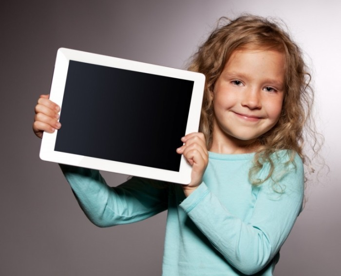 shutterstock 105496205 1024x832 700x568 Девочка с планшетом   Girl with a tablet