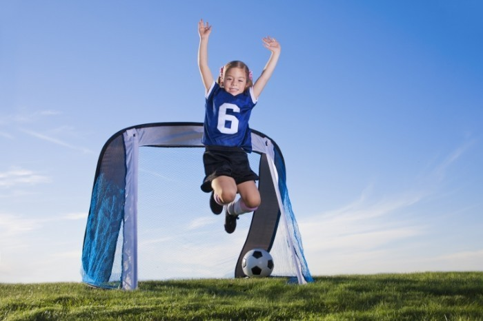 Fotolia 39263088 Subscription XL 700x466 Девочка с футбольным мячом   Girl with soccer ball