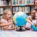 Дети возле глобуса - Children near Globe