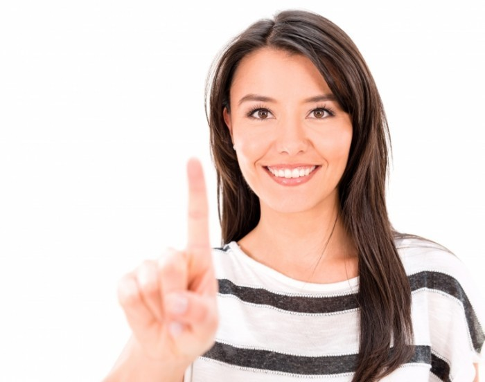 Dollarphotoclub 56852428 700x552 Девушка с указательным пальцем   Girl with index finger