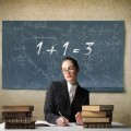 Учительница на фоне доски - Teacher on a background of the board