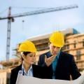 Архитекторы в строительных касках - Architects in construction helmets