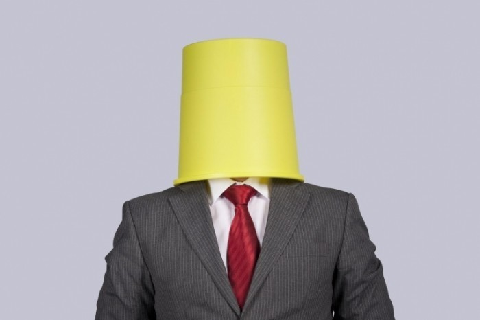 bigstock businessman with a bucket on h 15475226 700x466 Бизнесмен с ведром на голове   Businessman with a bucket on his head