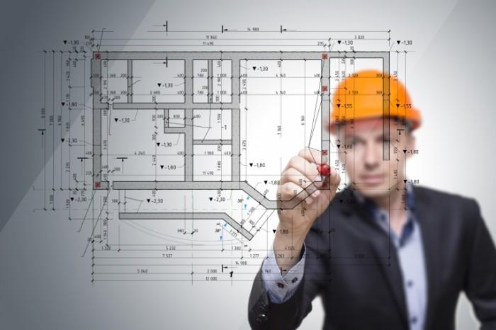 Dollarphotoclub 85340198 700x466 Строитель с чертежами   Construction worker with blueprints