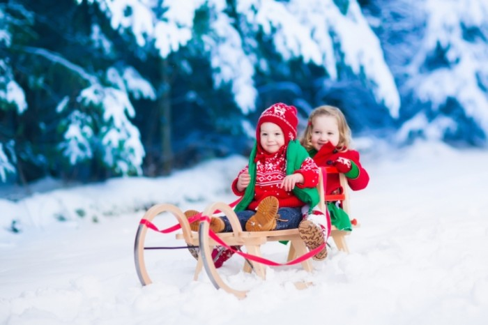 sledding winter shutterstock 331898564 700x466 Дети на санках   Children on sleds