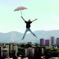 Дома, человек с зонтом - A man with umbrella